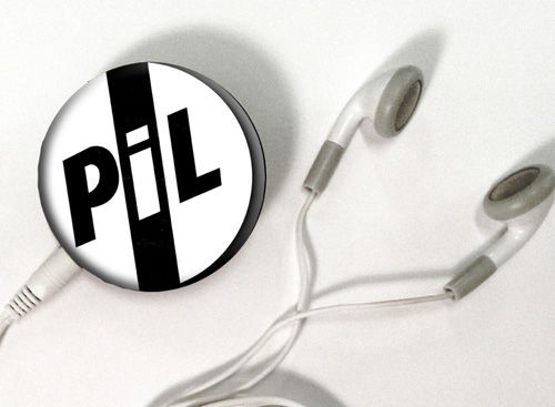 "PiL branded ""badge"" MP3 player loaded with all PiL Concert Live shows"